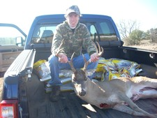 Cody takes a nice first buck with his bow.