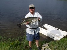 John with monster largemouth bass caught on a fly rod at Stillwaters Ranch.