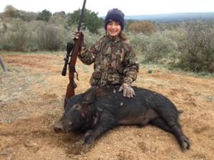 Kaitlyn takes a nice hog with her granddad. Way to go, Kaitlyn!